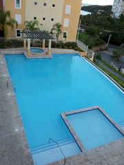 Fajardo condo photo - Main Infinity Pool with Jacuzzy