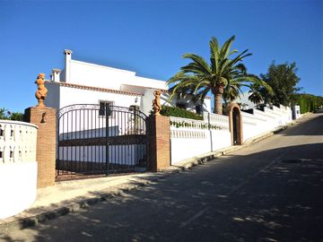 Front gates to large drive of Villa May