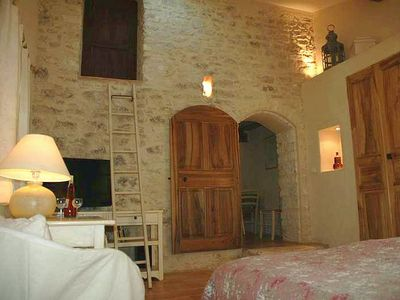 Master bedroom with restored antique doors and woodwork - Gite in Provence