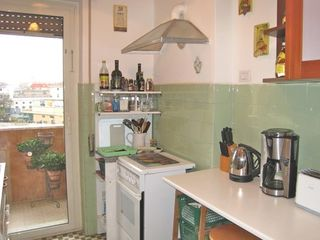 Trastevere area condo photo - The well equipped kitchen has everything you need.There is a door to the balcony