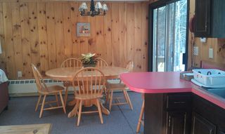 North Conway house photo - Bright and sunny kylit dining area. Seating for two at breakfast bar as well!!