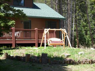 Blue River house photo - Enjoy the scenery from the front yard swing