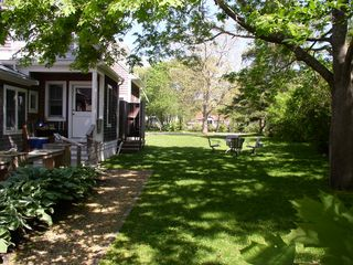 Oak Bluffs house photo - side yard w/ another table seating 4-one tenant set up volleyball here!