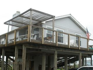 Galveston house photo - The front shaded deck, ramp and stairs.