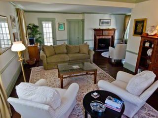 Edgartown house photo - Large Living Room Has Multiple Seating Areas & Fireplace