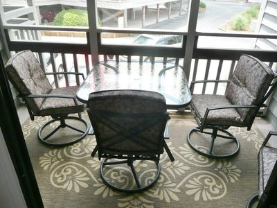 New rocker/swivel cushioned porch chairs and new dual layer porch carpets -2012