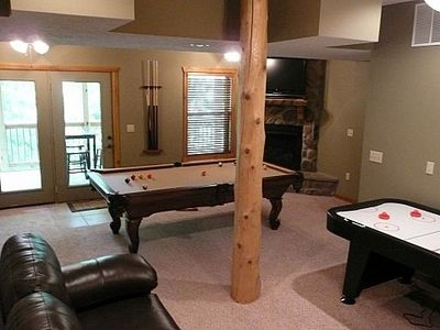 "Family room has second stone fireplace, pool table, air hockey, 40"" TV"