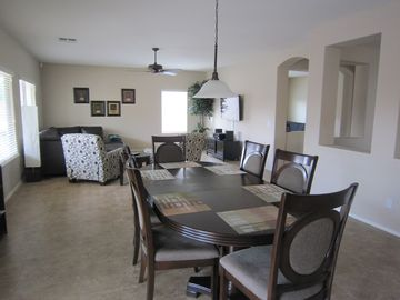 Dining room table comfortably seats 10 people with another table for 6 close by!