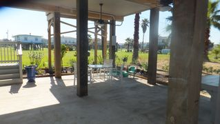 Galveston house photo - The shaded patio with ceiling fans, tables, chairs and rocker sofa. Really cool!