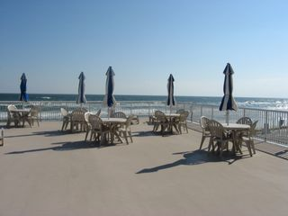 Daytona Beach condo photo - Large Oceanfront Sundeck with Umbrella Tables and Gas Grill