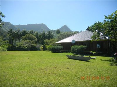 Side view of the property with mountain background and large garden
