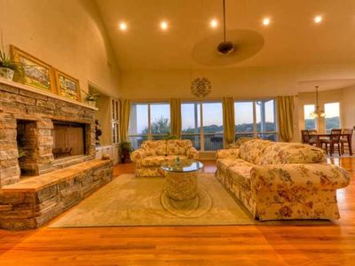 Beautiful open living room with panoramic views of Lake Travis, pool and spa!
