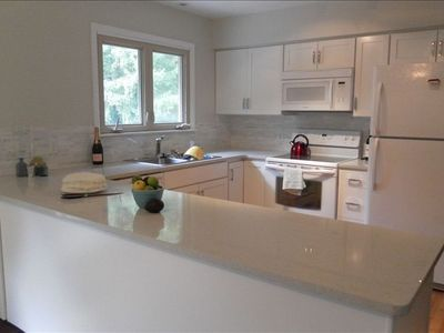Quartz countertop, brand new appliances, lots of light and space.