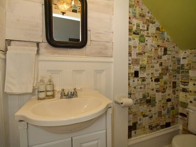 Our powder room decorated in wine labels and wine boxes.