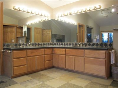 Double sink and granite counter tops in Master Bathroom. Beautiful slate floor.
