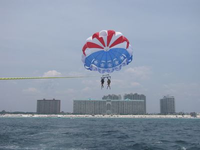 Majestic Sun condo rental - Our grandchildren Parasailing...see Majestic Sun in the background