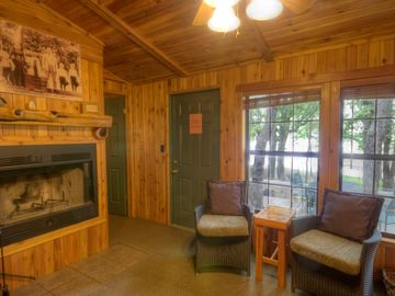 Lakeview living area of 2-bedroom cottage w/fireplace and jacuzzi tub