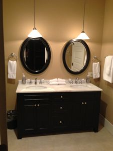 Light and Bright Lodge Suite Bathroom Features Marble Dual Vanity & Shower.