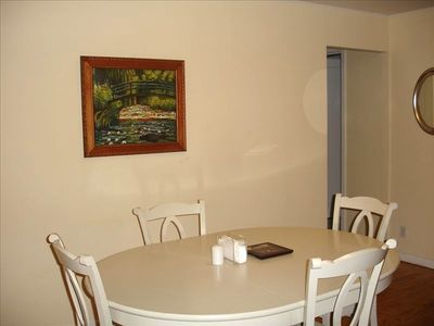 A beautiful impressionist oil painting hanging over the dining table