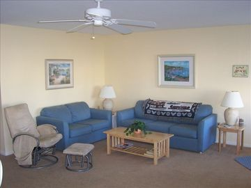 Spacious living area offers seating for 6 and a large TV with VCR and DVD