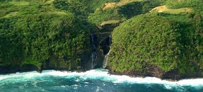 Take a helicopter tour of the island and see waterfalls and whales!