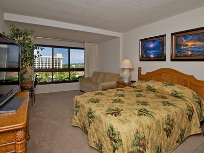 Master bedroom has large flat screen TV with an ocean view