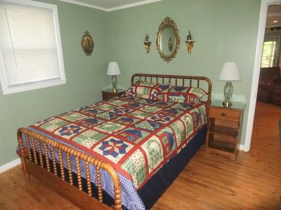Queensize bed in the master bedroom with triple high-threadcount sheets.