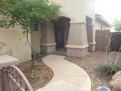 Beautiful entrance to the front of the house with gated courtyard