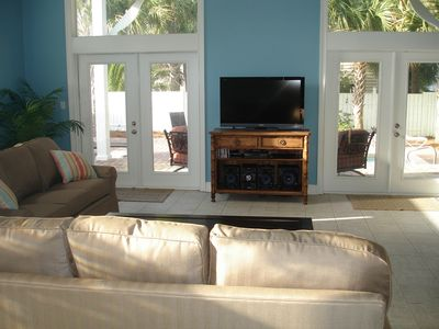 The family room with large screen TV looks out to