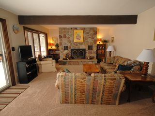 Hillman house photo - Brand new carpeting and cozy furniture offers a nice spot to take a break