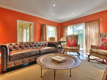 Montecito house rental - Formal Living - Our bright living room with luxury leather furniture, accent chairs, and wet bar.