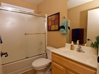 Gilbert house photo - Large Guest Bathroom adjacent to the Guest Bedroom has Shower/tub combo.