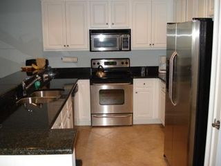 Wild Dunes condo photo - Beautiful Granite & Stainless Kitchen with convection oven!