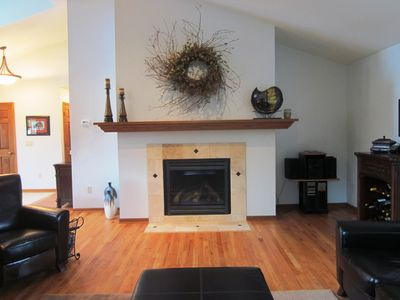 Enjoy this gorgeous gas fireplace and sink back into the comfy couches and relax
