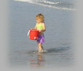 Kiawah Island villa photo - Children enjoy playing in the ocean surf.