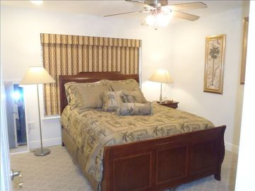 2nd Bedroom with Queen Bed, closet, dresser and TV