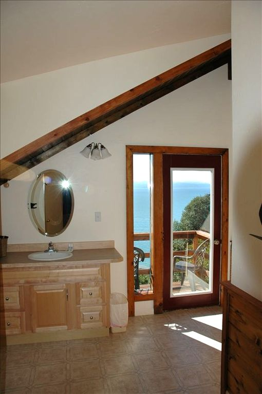 The upstairs bathroom is spacious, has a view and a cute little porch too!