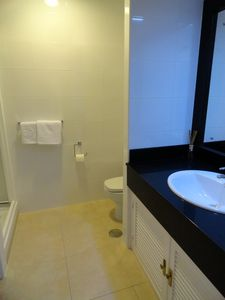 Bathroom two with shower, toilet and wash basin