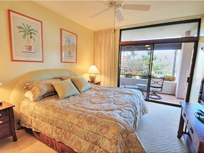 The master bedroom shares a lanai with the living room, overlooking the pool.