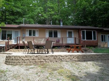 Pentwater cottage rental - Peaceful retreat in a natural setting - enjoy a meal or fire on the patio