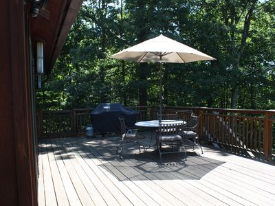 Relax and get your grillin on-property is wrapped by trees for privacy