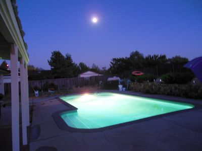Grass Valley house rental - Pool lights at night, with full moon, twinkling garden & orchard lights.