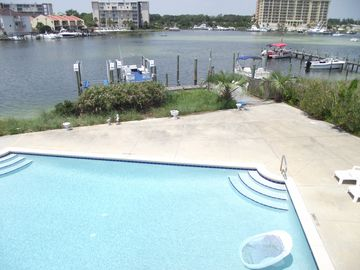 Vacation Homes in Holiday Isle Destin townhome rental - Veiw of Destin Harbor, Boat Slips and Pool from Living area and Master Bed Room