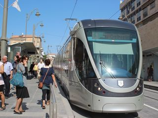 Light rail stop next to our building - travels through central Jerusalem - Jerusalem area apartment vacation rental photo