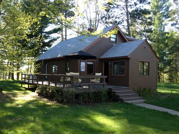 Gull Lake cabin rental - Front of house with water behind cabin
