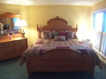 One of the two master bedrooms