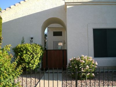 Front entry into patio and front door