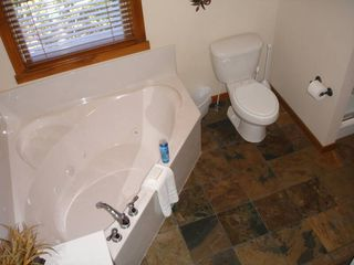 Branson cabin photo - Main Level - Jetted Tubs with Walk In Showers