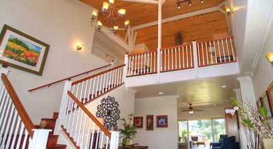 Dramatic 2 story entrance with ample island breeze throughout the home.