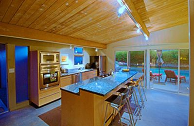 Full gourmet kitchen with counter seating for four